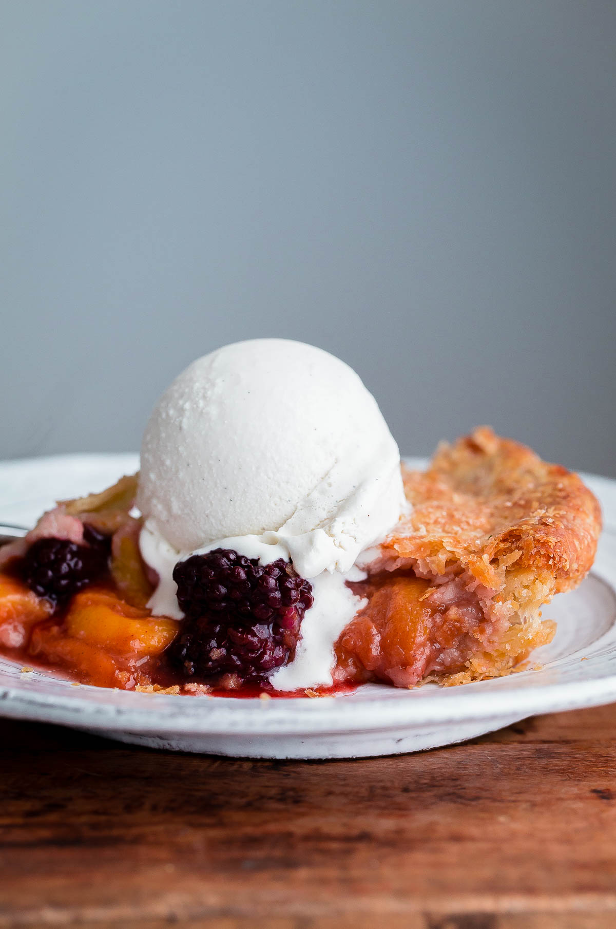 Blackberry Peach Pie. The BEST all-butter flaky pie crust filled with ripe summer peaches and blackberries!