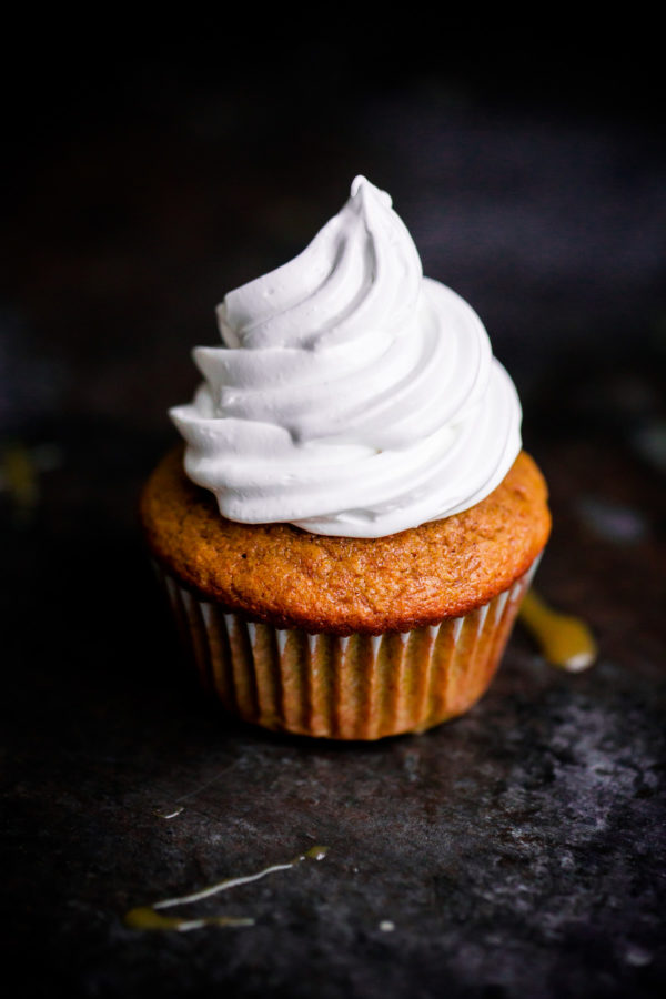 EASY Pumpkin Cupcakes topped with marshmallow frosting!