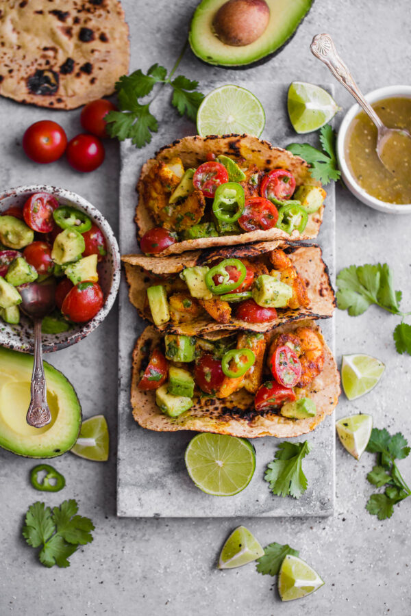 Mumbai Shrimp Tacos with Avocado Salsa - this EASY shrimp taco recipe is packed with spice and topped with a simple avocado tomato salsa!