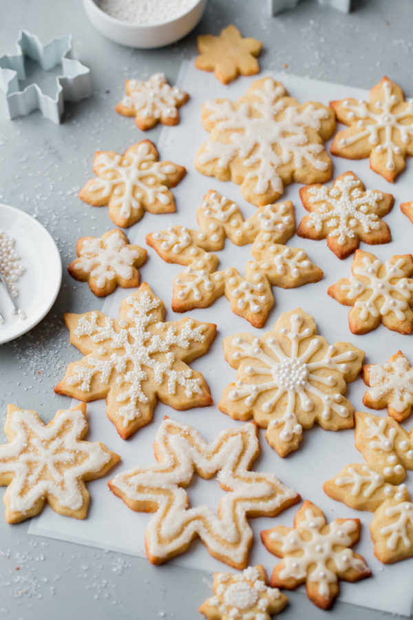 Almond Sugar Cookies - delicious crisp, tender, and buttery sugar cookies made with almond meal and flavored with almond extract and fresh orange zest. Topped with a simple cookie icing!