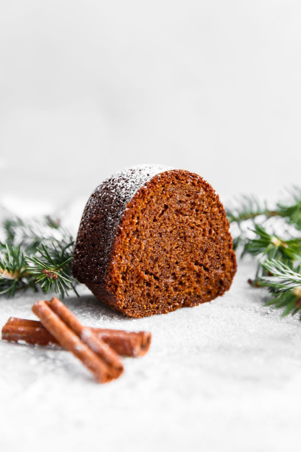 Gingerbread Bundt Cake - this easy, perfectly spiced MOIST bundt cake is served with an eggnog whipped cream. A festive cake recipe for the holiday season!