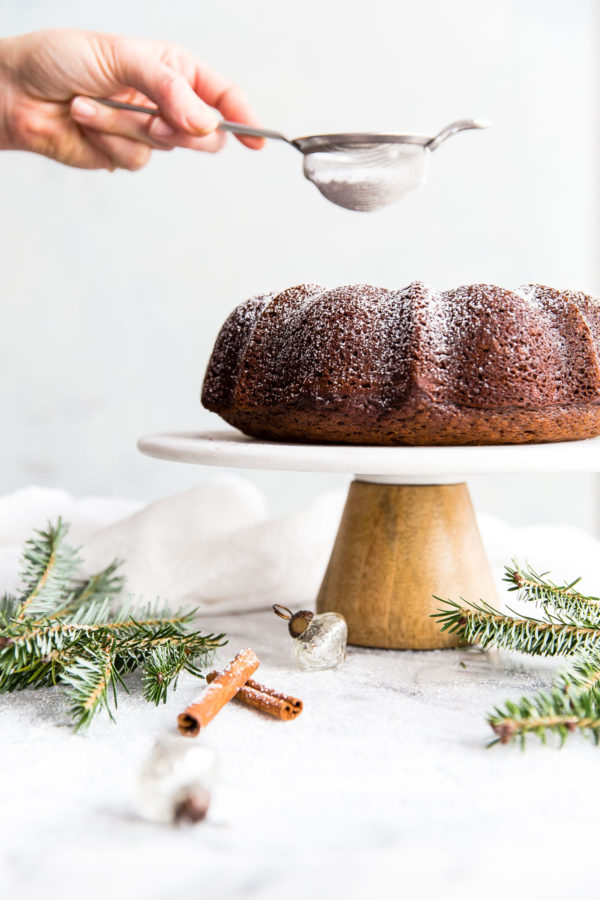 Gingerbread Bundt Cake - this easy, perfectly spiced bundt cake is served with an eggnog whipped cream. A festive cake recipe for the holiday season!