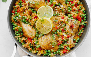 Arroz Con Pollo - an easy, comforting ONE pot meal that comes together in less than 45 minutes. This classic Spanish and Mexican dish is made with rice, chicken, bell peppers, and spices.