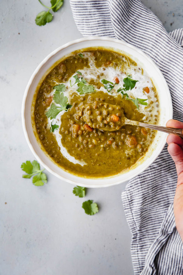 Slow Cooker Curried Lentil Soup - an EASY flavorful lentil soup flavored with turmeric, ginger, cardamom, cloves, cinnamon, and coconut milk.
