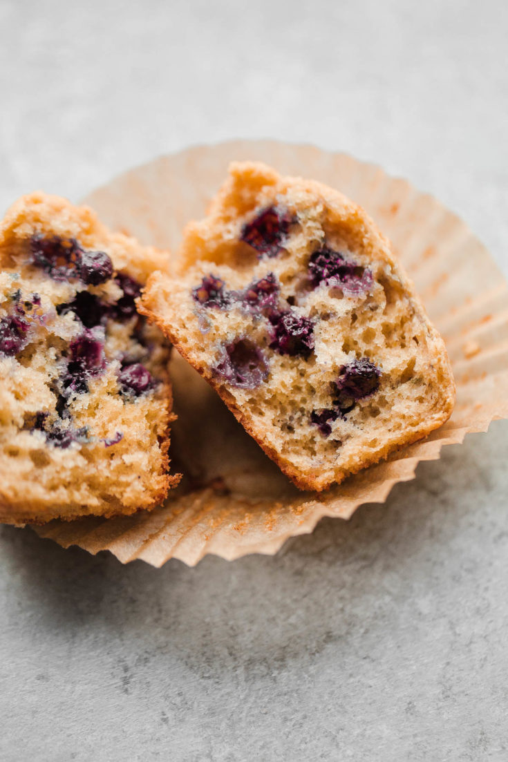 EASY Blueberry Muffins - this delicious whole wheat blueberry muffins recipe that comes together quickly and is made with coconut oil, buttermilk, and wild frozen blueberries. #blueberries #buttermilk #wholewheat #muffins #abeautifulplate #coconutoil #berries