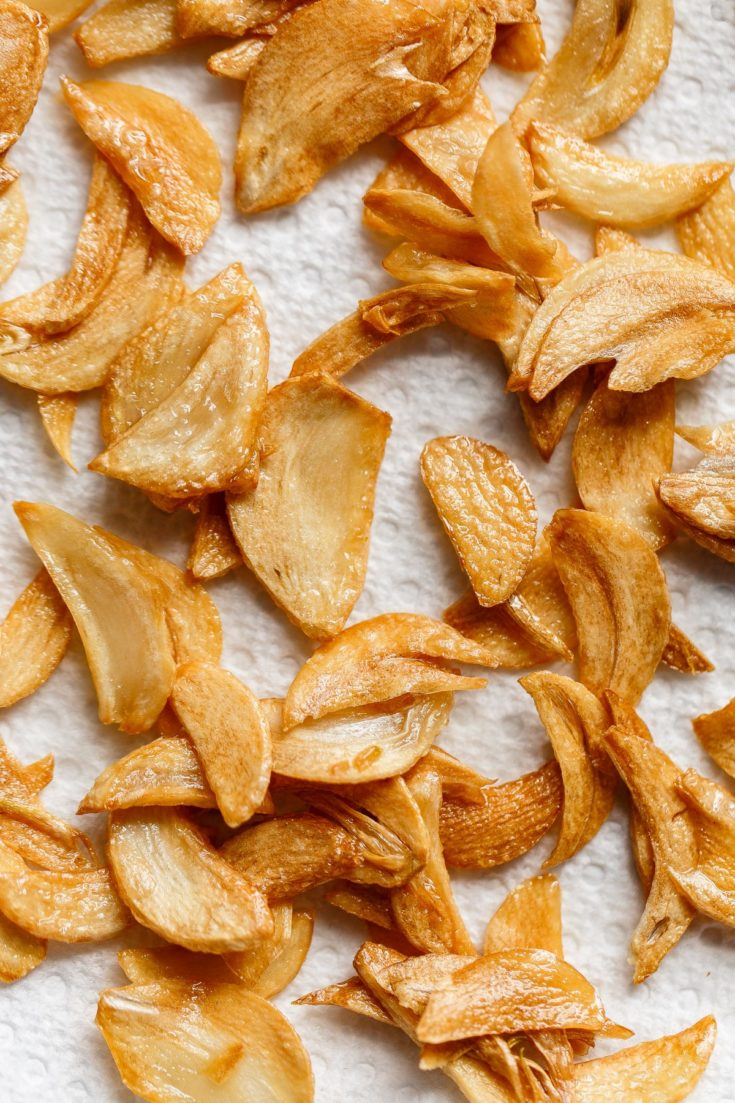How to Make Crispy Garlic Chips - An easy, no-fuss tutorial on how to make crispy garlic chips at home, and ways to incorporate them into your cooking repertoire. #abeautifulplate #recipe #garlic #chips