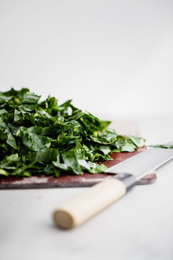 Chopped Collard Greens on Cutting Board