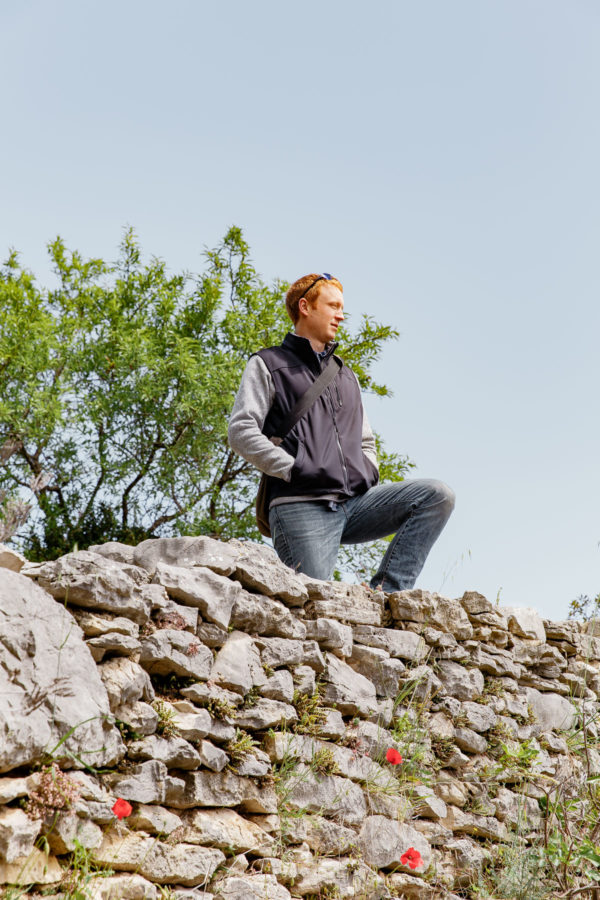 Man on Ruin Wall
