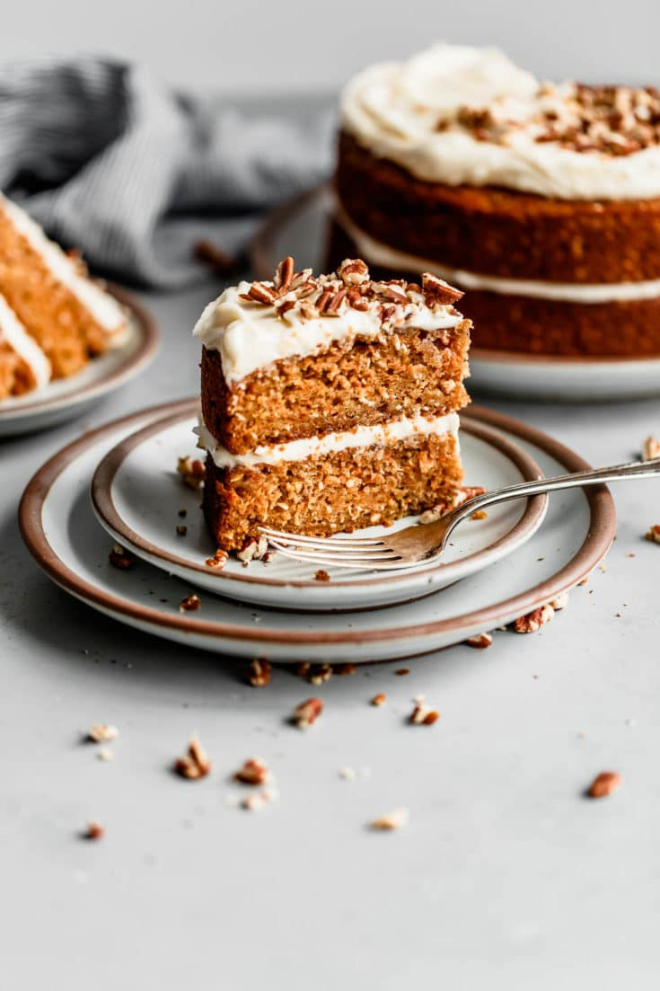 Carrot Cake with Lemon Cream Cheese Frosting - the best carrot cake with pineapple and coconut! This easy carrot cake recipe is perfect for Easter Day or any day of the year. #carrotcake #recipe #abeautifulplate #coconut #pineapple #easter #holiday #cake