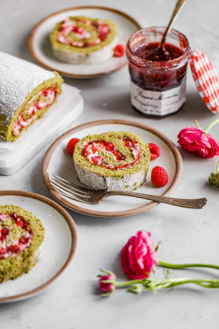 Raspberry Matcha Cake - this matcha roll cake is filled with Bonne Maman Raspberry Preserves and a light raspberry cream filling. An elegant, light, and fruit forward cake to serve for Easter brunch or year round! #easter #matcha #roll #cake #swissroll #cake #recipe #abeautifulplate