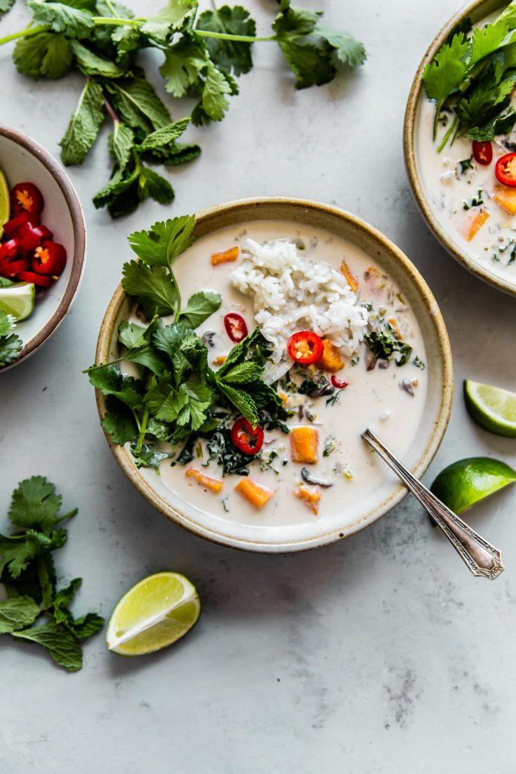 Vegetarian Thai Coconut Soup (Easy Tom Kha Gai) - a delicious, fragrant, vegan Thai coconut soup prepared with sweetpotato and kale. #coconutsoup #tomkhagai #thai #recipe #soup #vegan #glutenfree #dairyfree #vegetarian #abeautifulplate #recipe