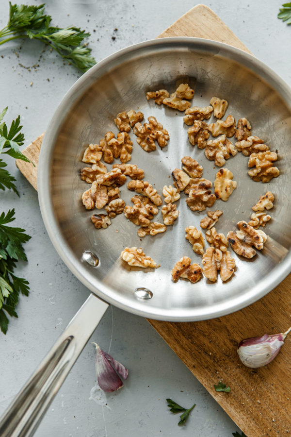 Toasted Walnuts in a Skillet