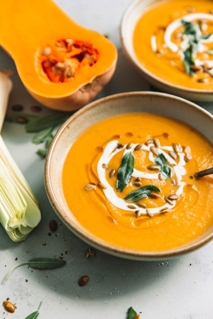 Caramelized winter squash, creamy leeks, and fresh sage come together in this vibrant and naturally creamy Roasted Butternut Squash soup. #soup #butternutsquash #recipe #easyrecipes #squash #abeautifulplate
