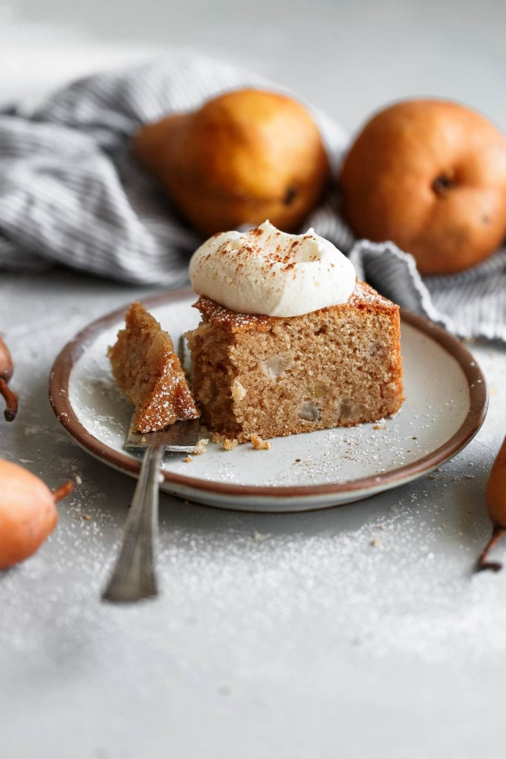 Spiced Almond Pear Cake -This easy pear cake recipe gets its amazing flavor from almond flour and almond extract. Studded with chopped Bosc pear and infused with cinnamon, clove, and ginger, this seasonal cake that comes together quickly and easily!  #pear #almond #cake #dessert #abeautifulplate #recipe #thanksgiving #holiday #christmas