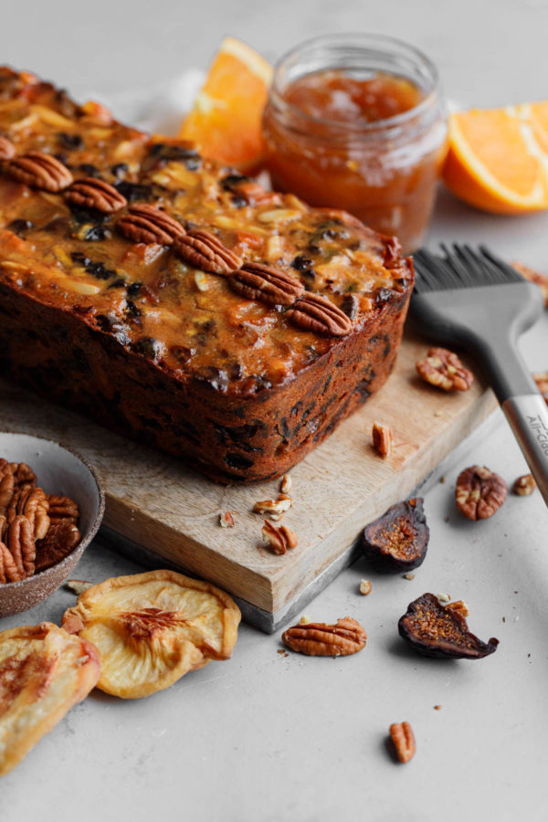 Moist Fruit Cake Topped with Whole Pecans and Apricot Glaze