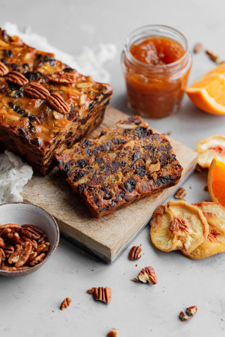 A traditional moist fruit cake made with rum soaked dried fruit, citrus zest, and candied ginger. The best fruit cake recipe you'll ever make!  #abeautifulplate #holiday #christmas #fruitcake #cake #recipe