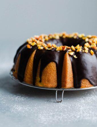 Orange Bundt Cake with Chocolate Glaze topped with Candied Orange Pieces