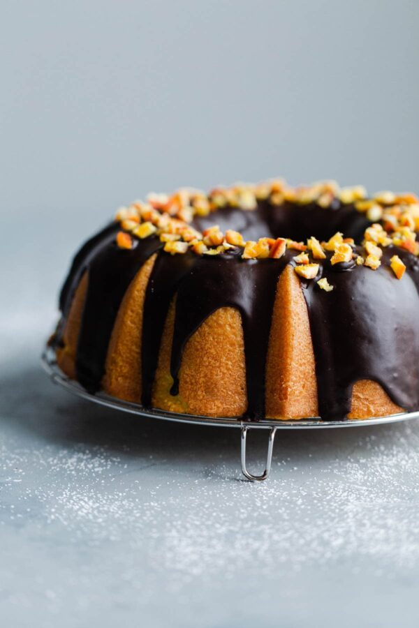 Orange Bundt Cake with Chocolate Glaze topped with Candied Orange Pieces
