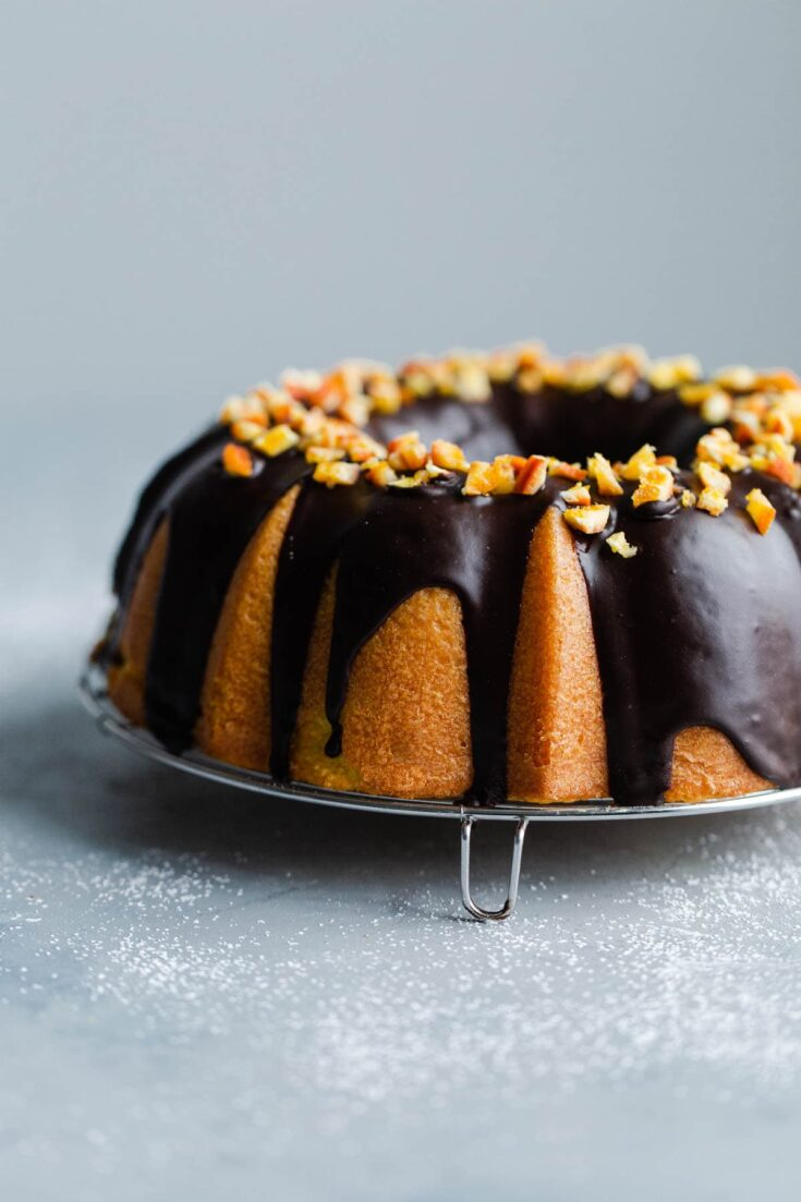 Orange Bundt Cake with Chocolate Glaze - this orange cake has a tender moist crumb and is topped with a dark chocolate glaze. Unfussy and not too sweet, it's ideal for sharing with a large gathering of friends and family! Sponsored by Bob's Red Mill. #holiday #christmas #orange #chocolate #cake #easydesserts #bundtcake #abeautifulplate