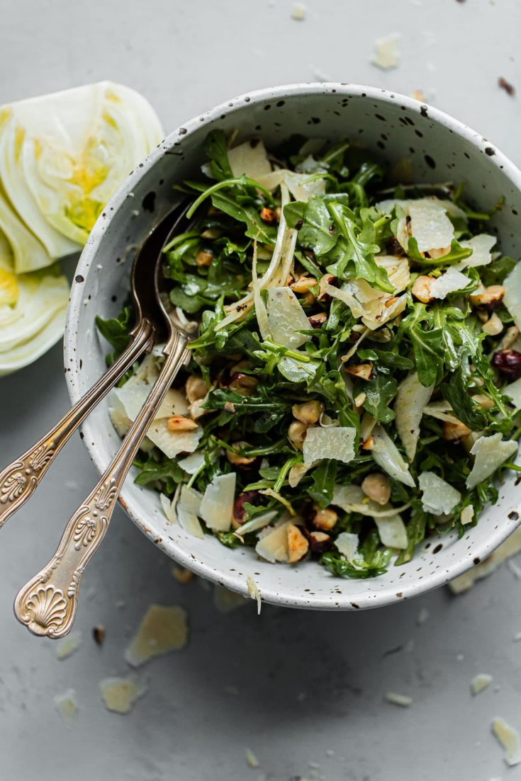 Shaved Fennel Arugula Salad with Hazelnuts, Parmesan, and Sherry Vinaigrette. A simple salad to enjoy year round. Great for everyday meals or special occasions! #abeautifulplate #salad #arugula #hazelnuts #parmesan #recipe
