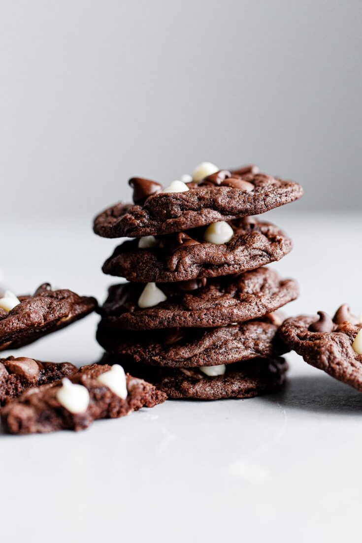 Triple Chocolate Cookies - Chewy triple chocolate cookies featuring semisweet, milk, and white chocolate chips. This chocolate cookie recipe is a chocolate lover's dream. #recipe #cookies #chocolate #abeautifulplate #desserts