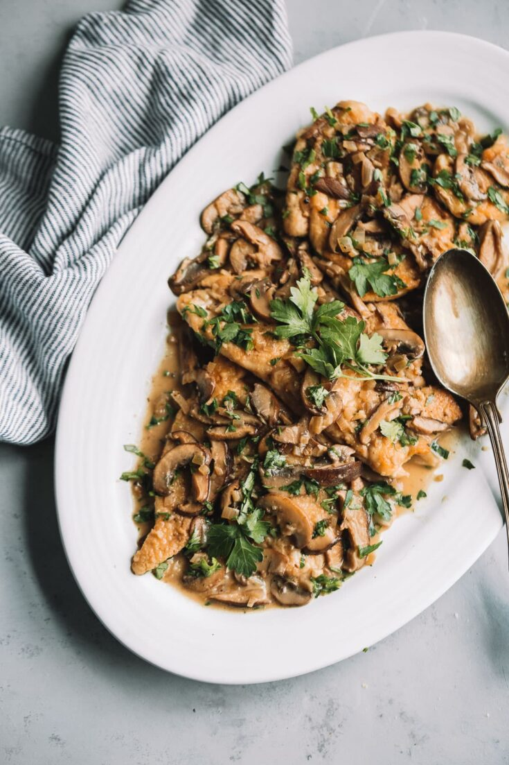 Healthier Chicken Marsala - this lightened up Chicken Marsala recipe is made with chicken cutlets, shallots, garlic, mushrooms, Marsala wine, chicken broth, and just a touch of heavy cream. #recipe #chicken #marsala #easydinner #italian #mushrooms #abeautifulplate