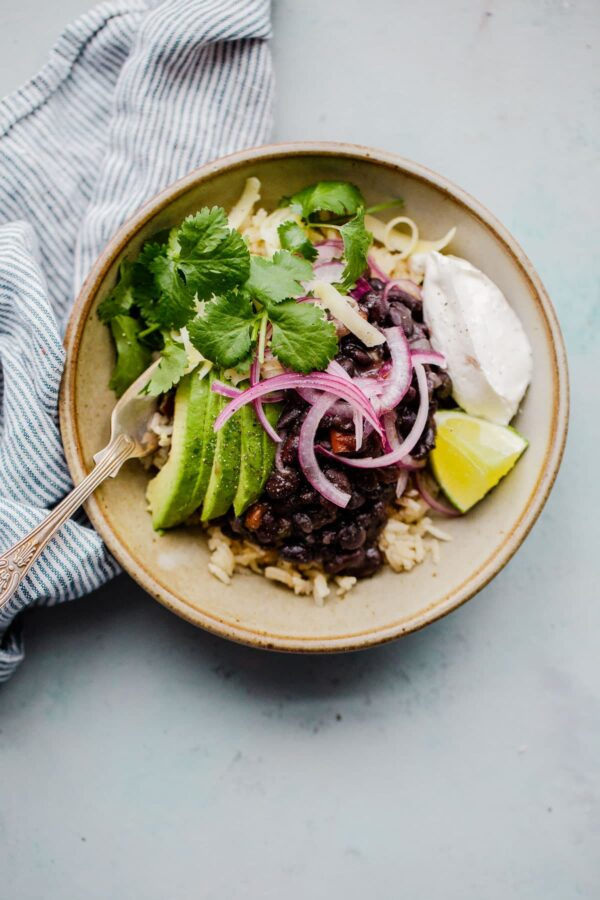 Pressure Cooker Black Beans in Bowl with Avocado and Toppings