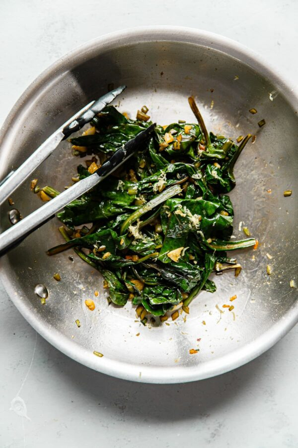 Sautéed Beet Greens in Skillet with Tongs