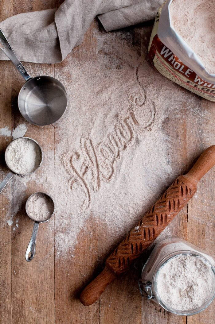 Flour Dusted on Wood Board with Measuring Cups