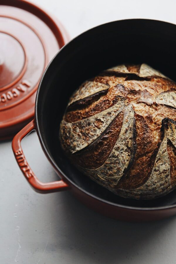 Baked Sourdough Bread Loaf in Staub Dutch Oven