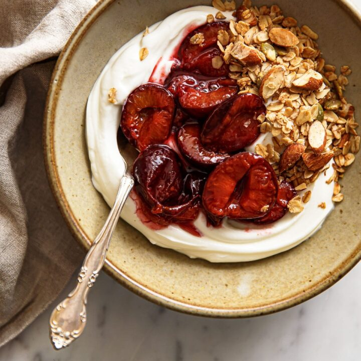 Roasted Plum Compote with Yogurt in Ceramic Bowl