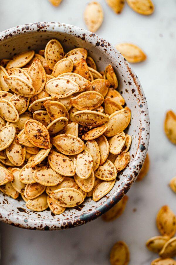 Za'atar Roasted Pumpkin Seeds in Speckled Ceramic Bowl