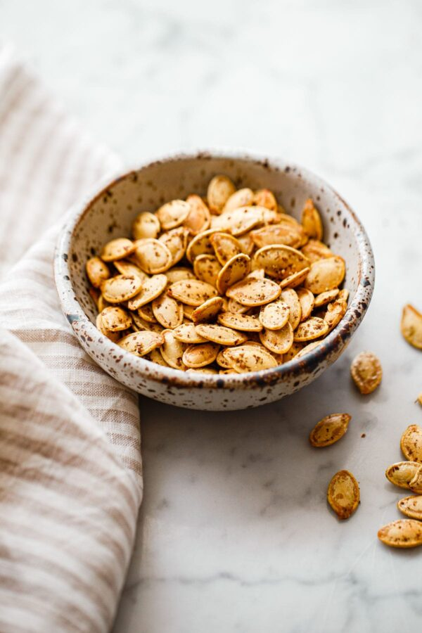 Za'atar Roasted Pumpkin Seeds in Small Ceramic Bowl