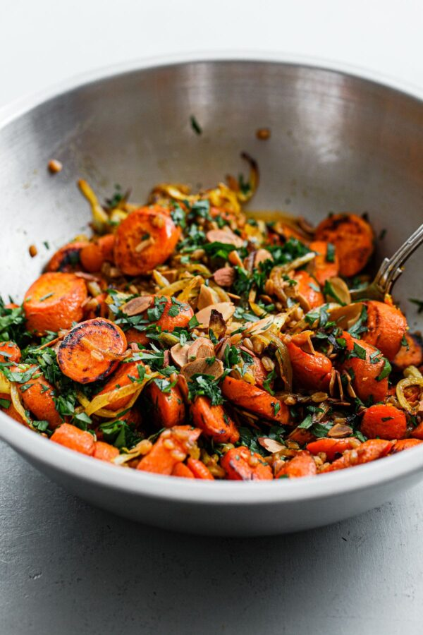 Roasted Carrots, Herbs, and Sliced Almonds in Stainless Steel Bowl