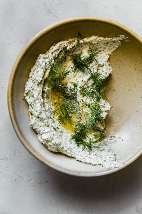 Garlicky Herbed Goat Cheese Spread in Ceramic Bowl